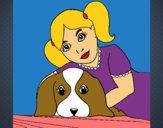 Menina a abraçar o seu cão